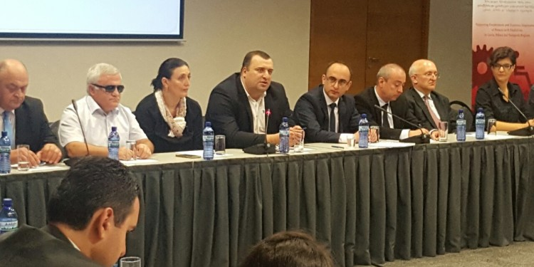 Meeting between business representatives and persons with disabilities